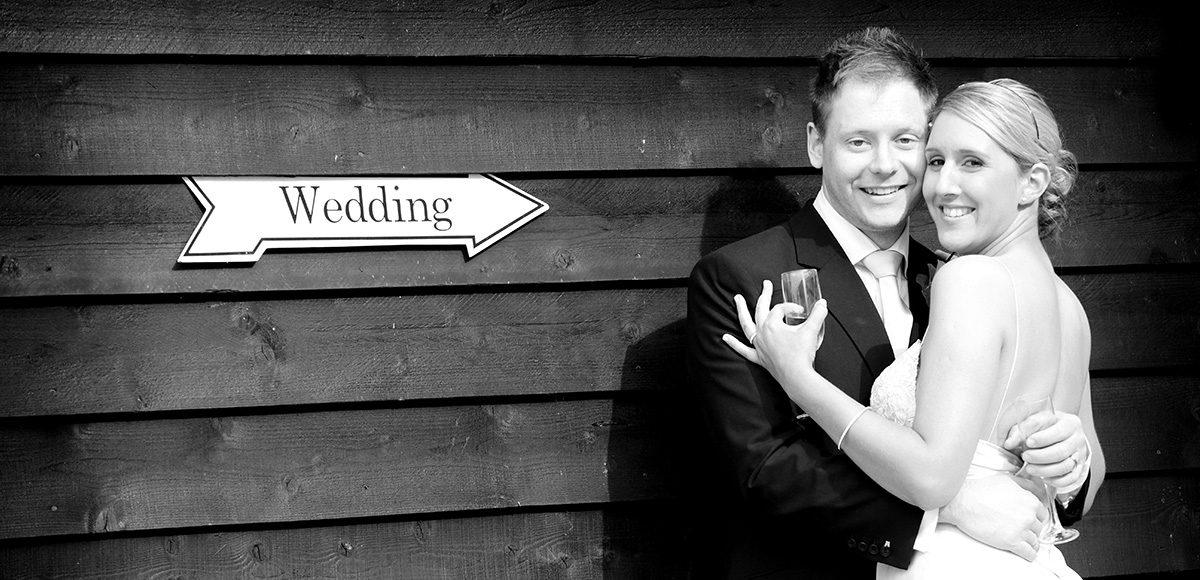 Bride and groom outside of Gaynes Park barn wedding venue in Essex
