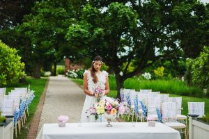 A bride steals a moment before the wedding ceremony - wedding table decorations