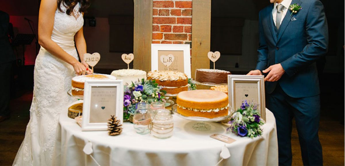 Cake table instead of traditional wedding cake for guests.