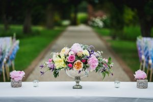 Pink and purple flowers are beautiful summer wedding colours - outdoor wedding