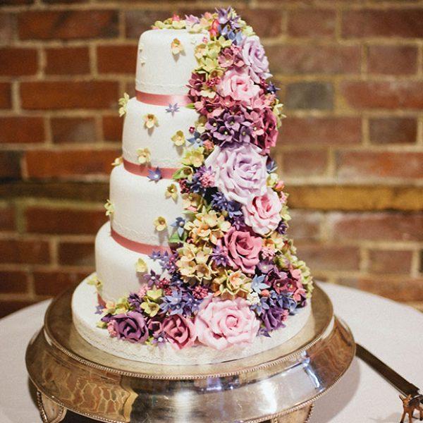 Pretty flower wedding cake for a Gaynes Park wedding