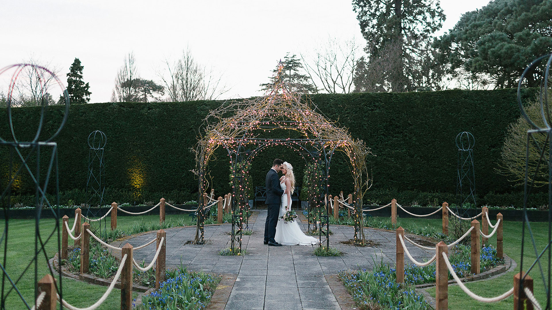 The romantically lit garden structure is a wonderful addition to your wedding photos - wedding ideas