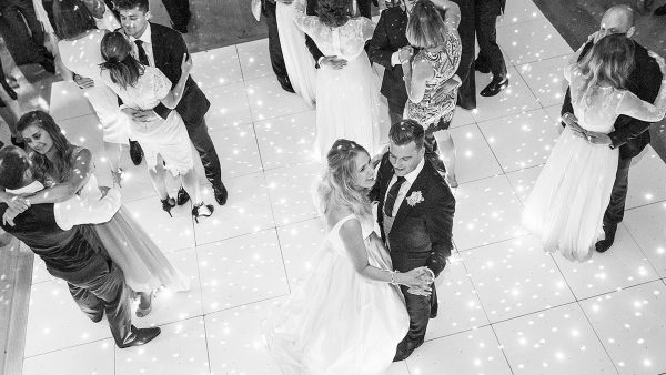 Guests dance in the Mill Barn during the evening wedding reception - barn wedding venue in Essex
