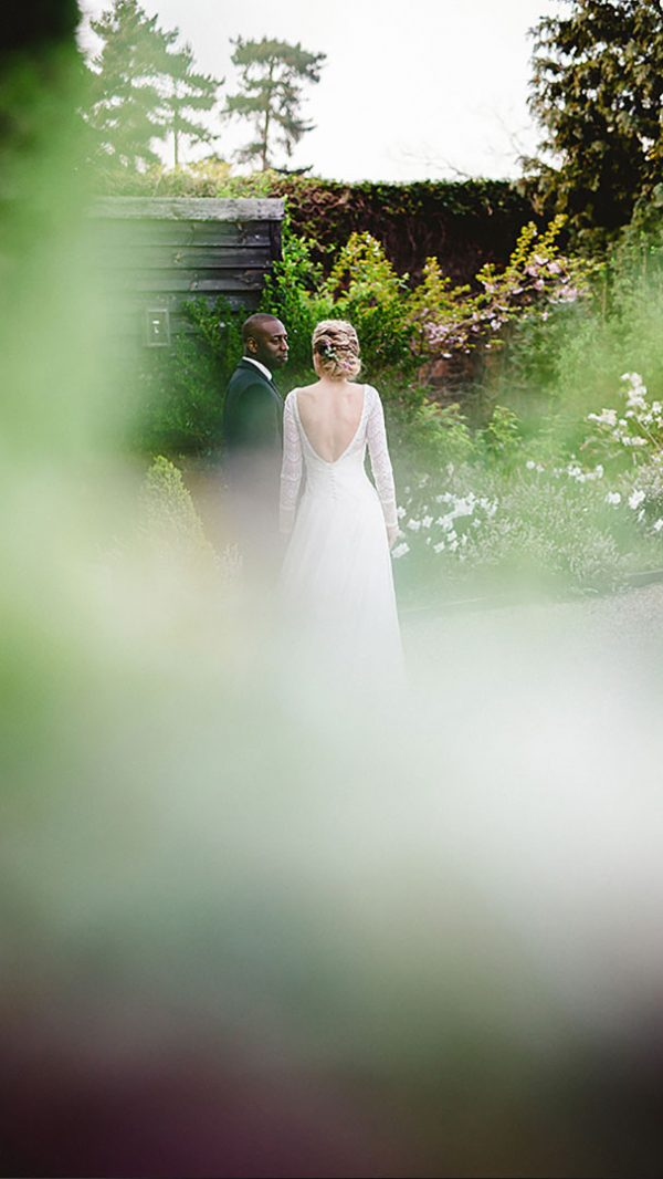 Couple share special moments as they stroll along the Long Walk - outdoor wedding venues Essex