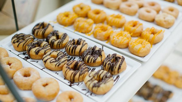 Guests will love these flavoured doughnuts at the sweet table - wedding reception ideas
