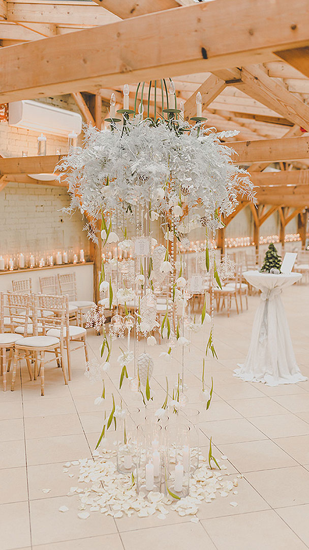 A stunning feature of petals, candles and white feathers is a wonderful addition to winter wedding decorations