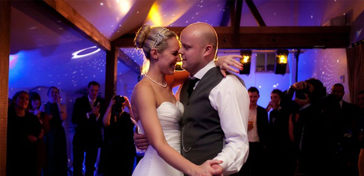 Bride and groom enjoy their first dance at their barn wedding Essex.