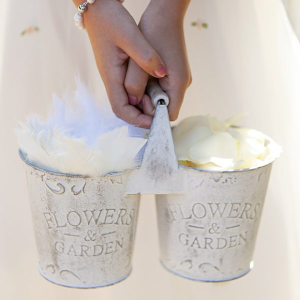 Easy to carry tins for flower girls filled with feathers and ivory confetti petals