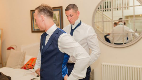 A groom and his groomsmen get ready in the stylish and contemporary wedding accommodation