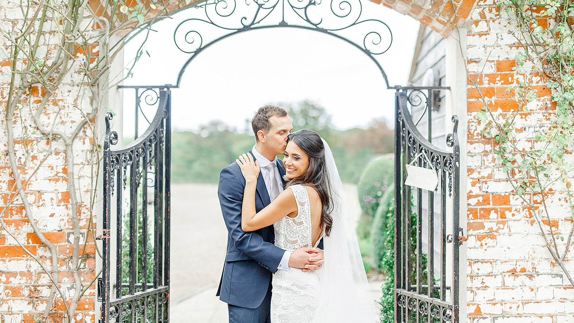 A groom kisses his bride in a special moment at this beautiful wedding venue in Essex - garden wedding