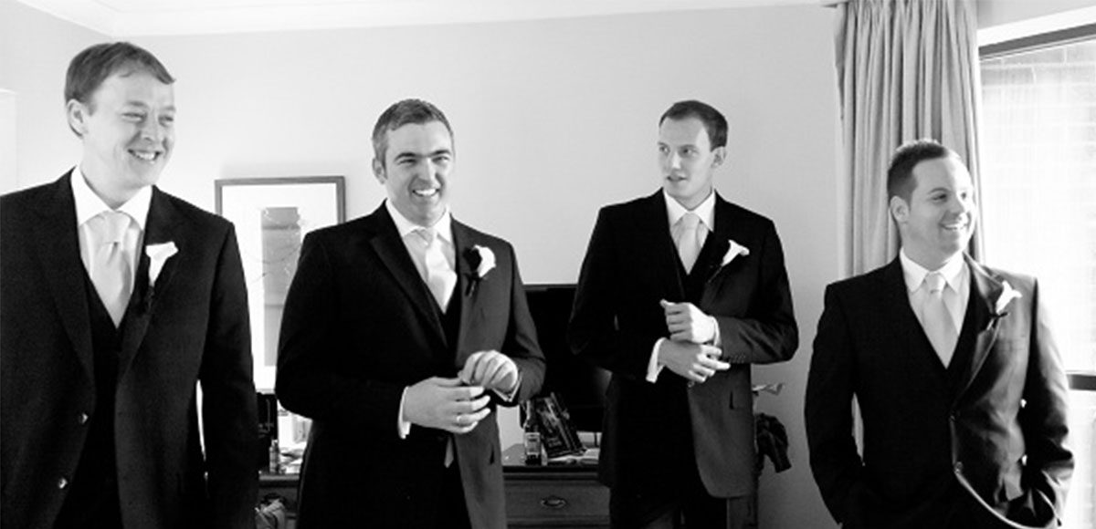 Groomsmen smiling and laughing before the wedding