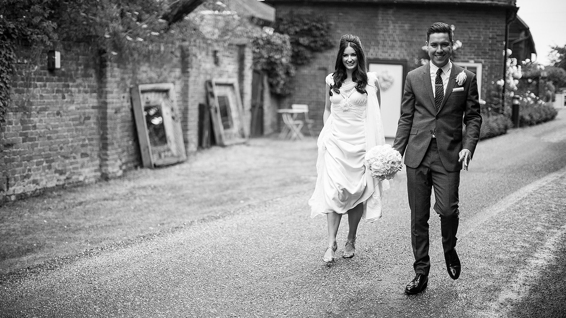 A happy couple enjoy a walk in the grounds of one of the finest wedding venues in Essex