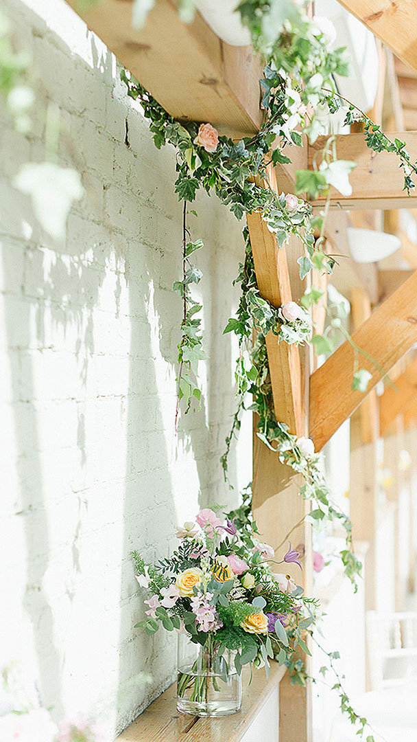 The beautiful oak beams are wrapped in Ivy for this gorgeous summer wedding - barn weddings Essex