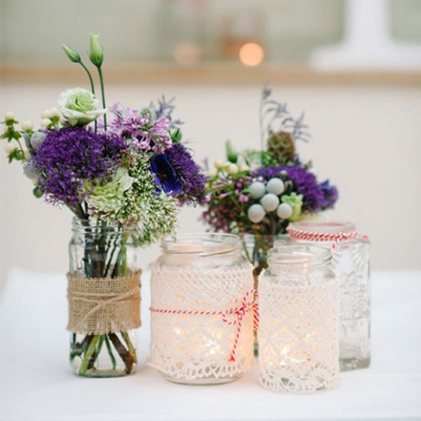 Jars used as vases for flower decorations for a Gaynes Park wedding.