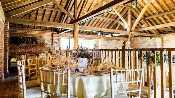 The stunning Mill Barn with exposed oak beams features a mezzanine for additional seating