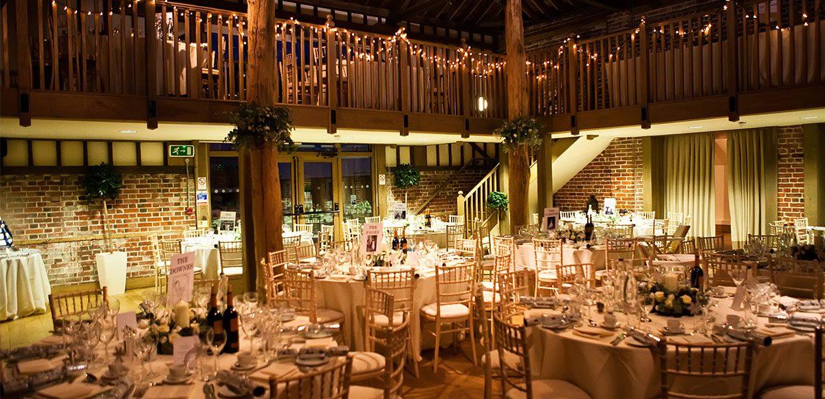 Mill Barn at Gaynes Park decorated for a wedding reception – barn weddings Essex