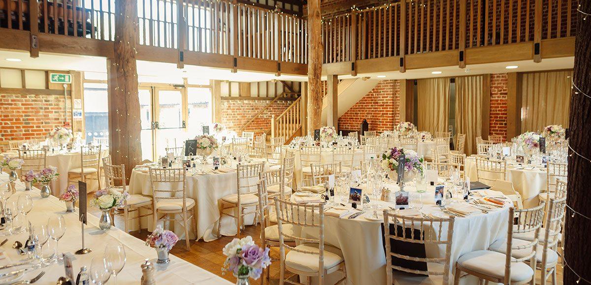 Tables decorated for a barn wedding reception – wedding barns Essex