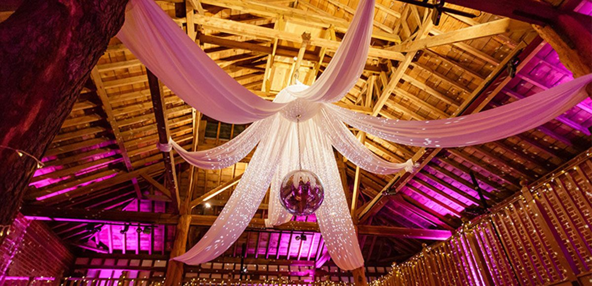 Drapes and disco ball in the Mill Barn at Gaynes Park - wedding venues in Essex