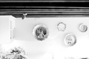A bride gets ready for her wedding day in the Apple Loft Cottage - wedding hair wedding make-up