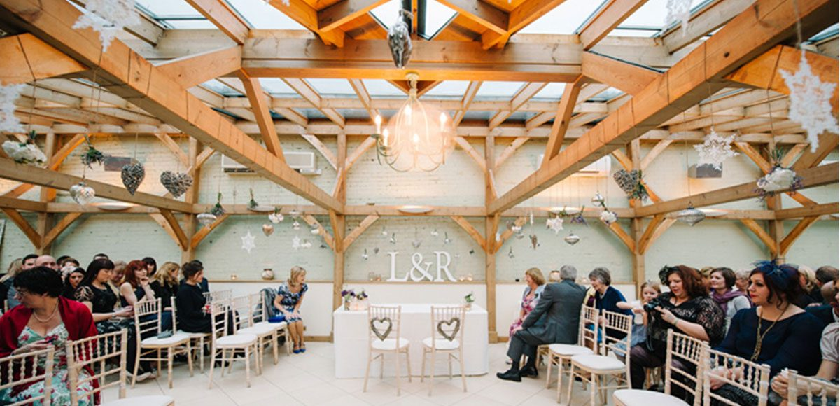 The Orangery at Gaynes Park set up for a ceremony – venue hire Essex.