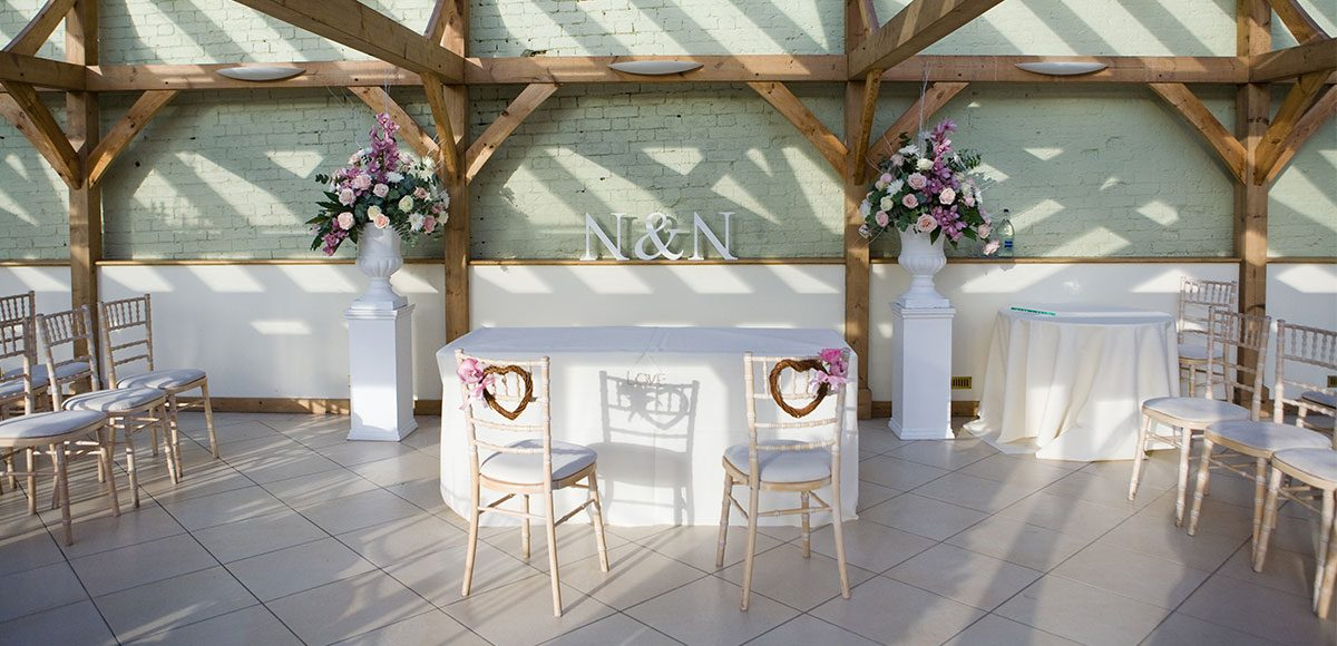 The Orangery set up with roses and flower hearts