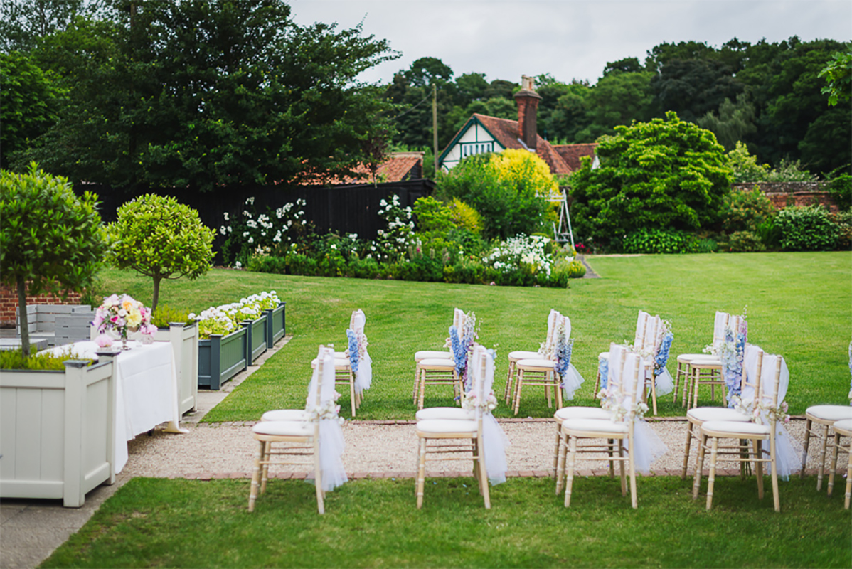 White Wooden Chairs Line The Long Walk Bringing The Wedding Ceremony Outdoors Wedding Places Gaynes Park