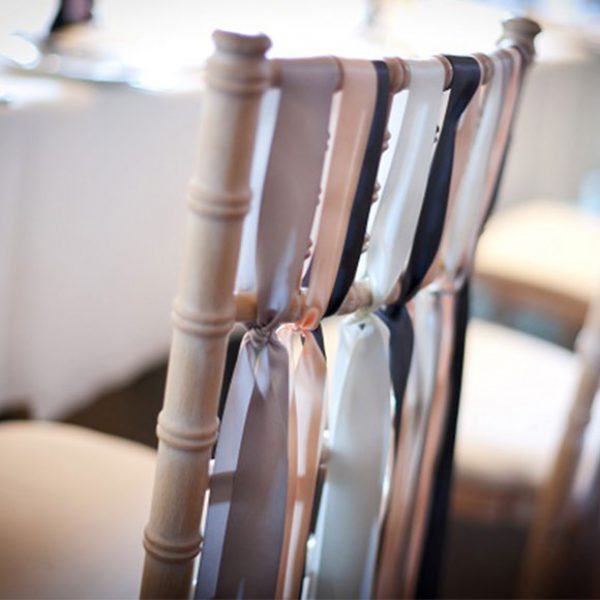 Ribbons used to decorate the chairs at a barn wedding venue in Essex.