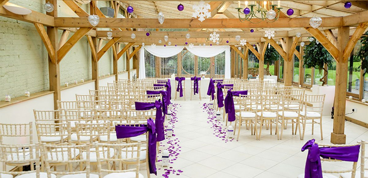 The Orangery dressed in a purple winter theme for an Essex wedding.