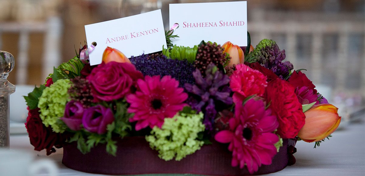 Pink and purple flower wedding table decorations for a barn wedding in Essex