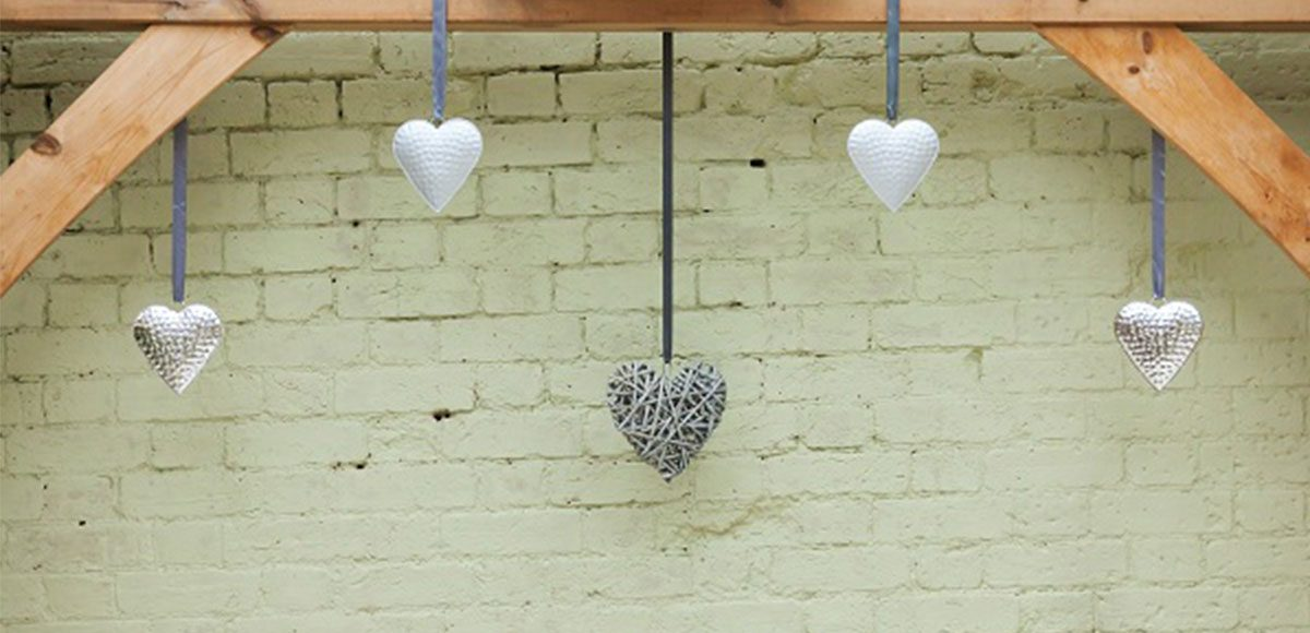 Silver hearts hanging in the Orangery as wedding decorations – wedding venues in Essex