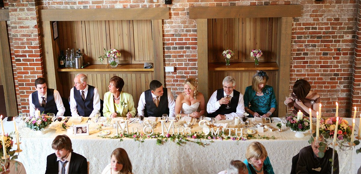 Top table with wedding guests and decorations – wedding barns Essex