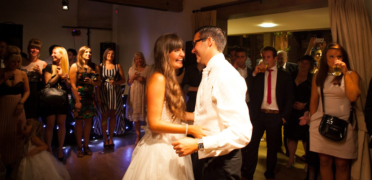 Wedding couple take to the dancefloor for their first dance