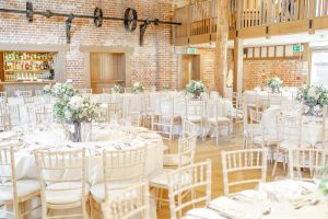 White wedding flowers adorn the tables of a beautiful winter wedding at Gaynes Park