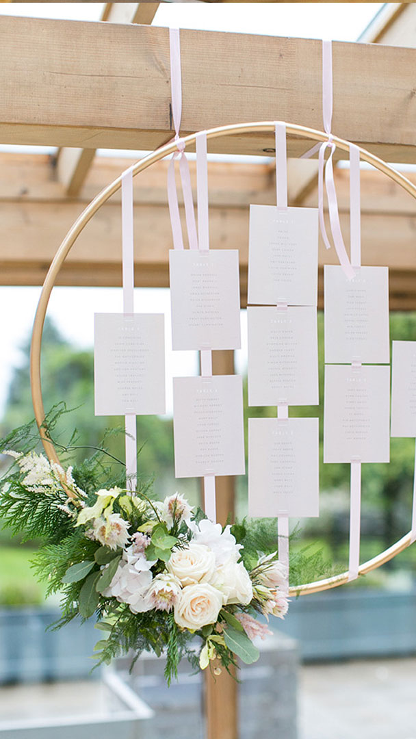 A gorgeous wooden hoop floral wedding table plan is the perfect addition to your wedding decorations