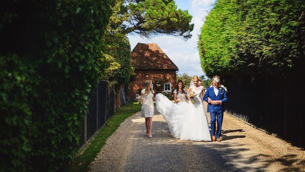 A stunning bride leaves the Apple Loft Cottage and walks to the Orangery to say her marriage vows