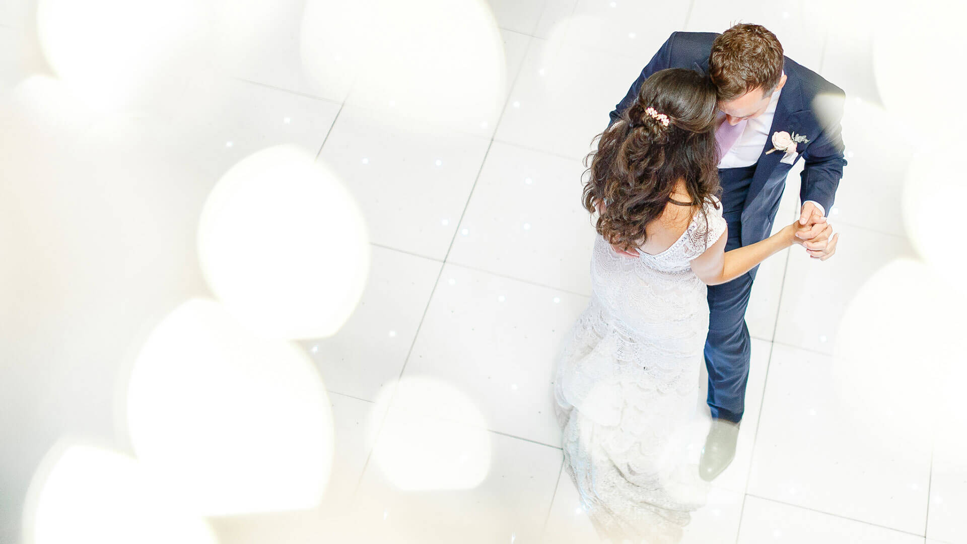 A happy couple enjoys their first wedding dance in the Mill Barn - barn wedding venues in Essex