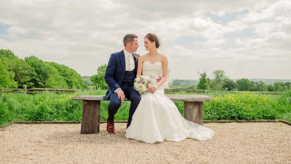 A happy couple share a moment together at this gorgeous country wedding venue in Essex