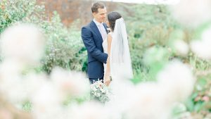 A happy couple steal a moment in the gardens which look stunning for a winter wedding