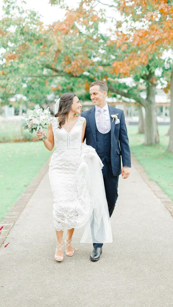 A bride and groom enjoy a moment together along the Long Walk after their wedding ceremony