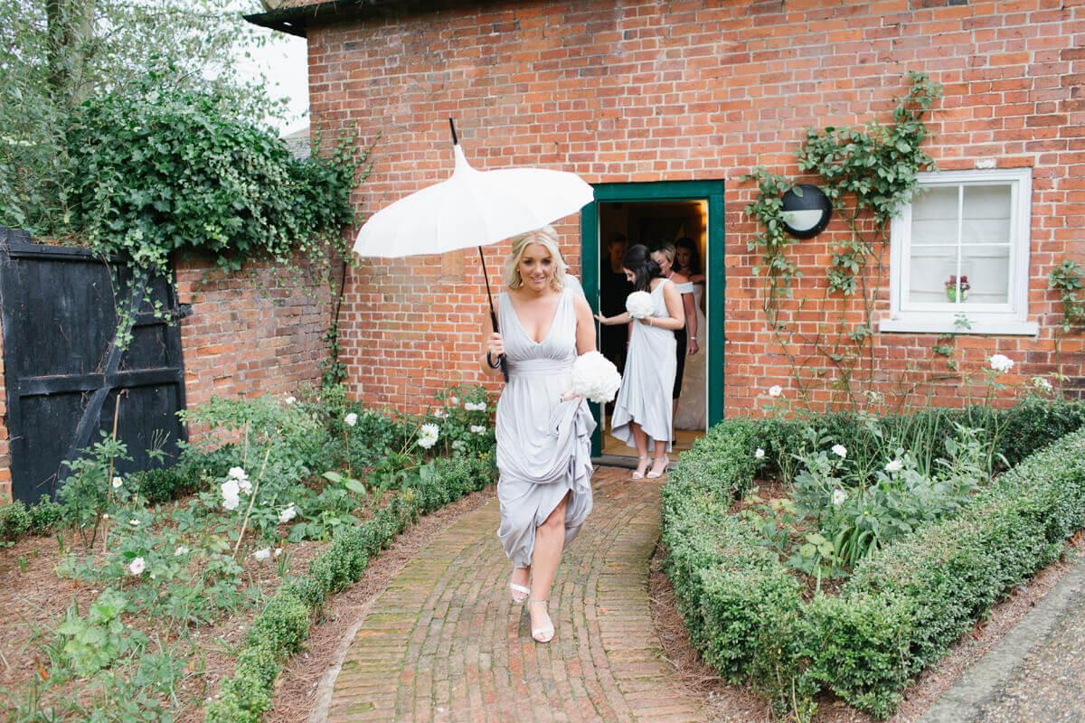 Bridesmaids-leave-honeymoon-cottage-for-wedding-ceremony