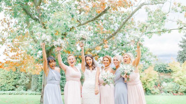 Bridesmaids dressed in pastel shades of pink and lilac - autumn wedding ideas