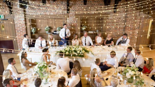 The Mill Barn is decorated with fairy lights - wedding decoration ideas and barn lighting