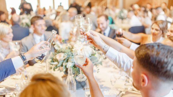 Guests raise a toast to the happy couple during the wedding reception - wedding barns Essex