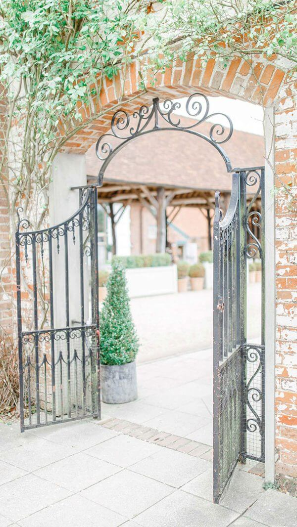 Couples can make their way through the iron gate from their wedding ceremony and into the wedding barn