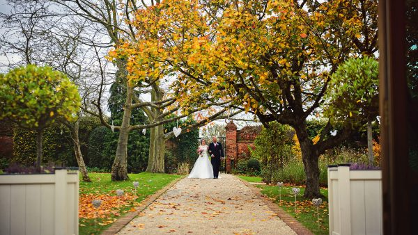 The gardens look beautiful in autumn as the leaves turn brown and begin to fall - autumn wedding