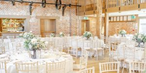 The Mill Barn looks beautiful decorated with white wedding flowers for wedding table centrepieces