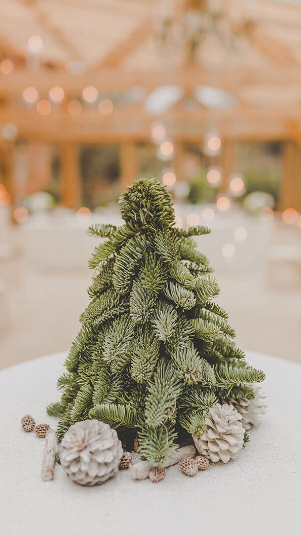 A Christmas tree inspires the wedding table centrepieces at this winter wedding - christmas wedding ideas