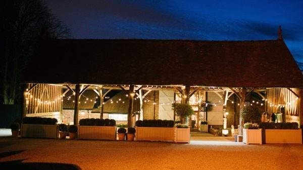 The Gather Barn looks romantic at night lit up with festoon lighting - barn wedding ideas