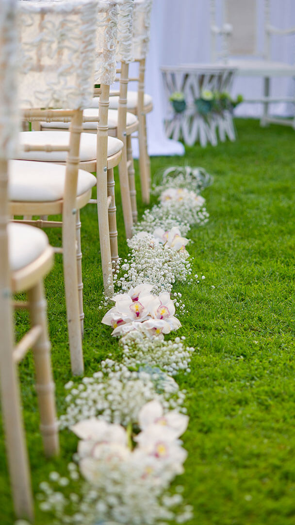 Stunning gypsophila lines the wedding ceremony aisle - white wedding ideas