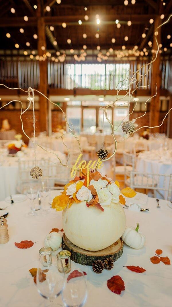 A white pumpkin table centrepiece looks fabulous for an autumn themed wedding